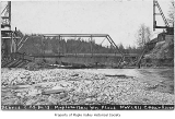 Columbia and Puget Sound Railroad Company bridge number 13 damaged after a flood, viewed from...