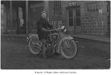 Motorcycle rider named Norman in front of post office, Taylor, n.d.