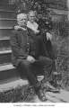 C.O. and Sarah Russell sitting on a stoop in Seattle, n.d.