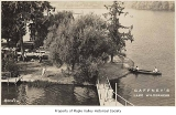 Gaffney's Lake Wilderness Resort lake shore, boardwalks and canoe, Maple Valley, ca. 1945