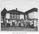 Hobart School before its demolition, with a group of people standing outside the building, Hobart,...