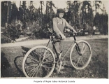 Dan Lagesson with a bicycle, probably in Maple Valley, ca. 1912