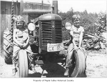 Anderson children Sherrie and Jerry on a tractor, probably in Hobart, ca. 1949
