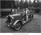 Howard Cooper fire engine after restoration with Puget Sound Power employees on the truck, Maple...