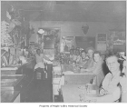 Maple Valley Tavern interior showing customers seated along the bar, Maple Valley, August, 1953