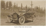 Clarence and Bertha Peterson in a car, probably in Maple Valley, ca. 1920