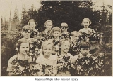 Students with bouquets at Crosson School, King County, 1916