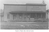 W.D. Gibbon Store and Post Office exterior showing three unidentified people near entrance, Maple...