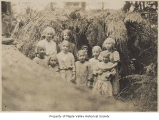 Children outside hemlock bush playhouse, Crosson School, King County, 1915-1917