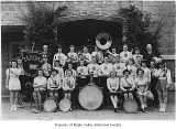 Tahoma High School band and drum majorettes outside the school, Maple Valley, ca. 1942