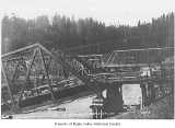 Chicago, Milwaukee, and St. Paul Railway Company bridge damaged after a flood, with another bridge...