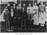 Hobart School seventh and eighth grade class standing outside school entrance with Richard...