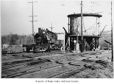 Pacific Coast Railroad Company tower beside engine number 16, 1943