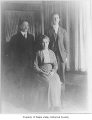W.D. Gibbon with Elizabeth and Chester Gibbon inside a house, probably in Maple Valley, n.d.