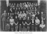 Tahoma High School class of 1939 in their senior year with Mr. Moore outside the school entrance,...