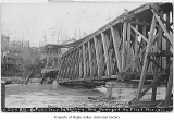 Columbia and Puget Sound Railroad Company bridge number 13 damaged after a flood, viewing the...