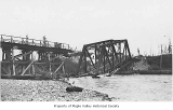 Chicago, Milwaukee, and St. Paul Railway Company bridge damaged after a flood, Maple Valley, 1911