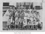 Hobart School seventh and eighth grade class outside school entrance with Mr. Still, Hobart, March...