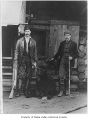 John Gibbon and friend with rifles and a hunted bear, probably in Maple Valley, n.d.