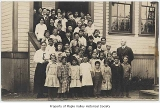 Maple Valley School students and faculty outside school entrance, Maple Valley, ca. 1916