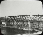 Wooden railroad bridge under construction, ca. 1930