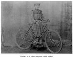 Janet Richmond (Faull) with a bicycle, 1899-1900