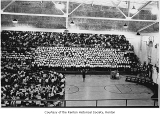 Renton High School assembly in the gymnasium with band and choir, Renton, n.d.