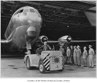 Mayor Perry H. Mitchell and others inspecting an airplane at the Boeing Airplane Company plant,...