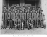 Fraternal Order of Eagles drill team with trophy outside entrance of Masonic Hall, Vancouver,...