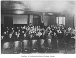 Renton High School auditorium interior showing students and Mr. Gould, Renton, ca. 1920