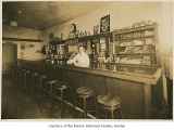 Bellando's Snappy Tavern interior showing William Bellando behind the bar, Renton, 1935