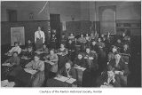 Central School students inside classroom with Florence (Storey) Guitteau, Renton, 1910