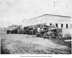 Puget Sound Power and Light Company exterior showing several people beside cars and trucks,...