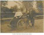 Beatrice and Al on gasoline powered bicycle, probably somewhere in Washington state, ca. 1907