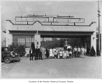 Barei Brothers Service Station exterior showing people posing near entrance, Renton, n.d.