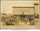 M. & H. Tire Shop exterior showing Jack McCrea outside entrance, Renton, before 1917