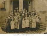 Central School students and teacher outside school entrance, Renton, 1900