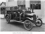 Renton Volunteer Fire Department Chief Joe Wood sitting in their first motorized truck, Renton,...