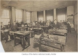 Renton High School interior showing a manual training class in the classroom, Renton, 1916