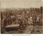 Hop field with a crowd of people near picked hops, possibly in Kent, 1900