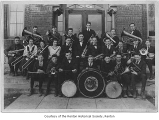 Renton High School Band outside the school entrance, Renton, March 19, 1920