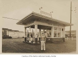 Phillips and Son Union Gasoline exterior showing Nando Phillips standing outside, Renton, ca. 1930