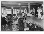 Barei Family Store interior during a flood, Renton, ca. 1935