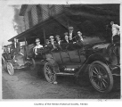 Frank (Frenchy) Vaise and other men in cars outside the hotel at Williams and Walla Walla...