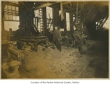 Pacific Car and Foundry Company interior showing Will Burnett inside a car shop, Renton, n.d.