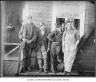 George Pritchard, John Faull, Jimmie Walters and Tom Oughton in front of Renton Coal Mine office,...