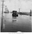 McGarrigle family's car driving through a flooded roadway, Renton, 1926