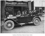 Puget Sound Savings and Loan Company founders in a car outside local branch, Renton, 1918