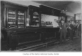 Alki Bar interior showing customers at the bar, Renton, n.d.