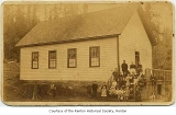 Renton schoolhouse exterior showing students and teachers near front entrance, Renton, between...